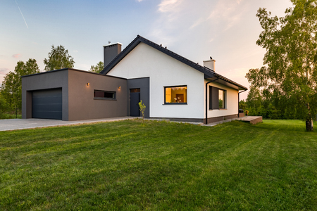 Foto de Stylish house with large lawn and garage, outdoors - Imagen libre de derechos