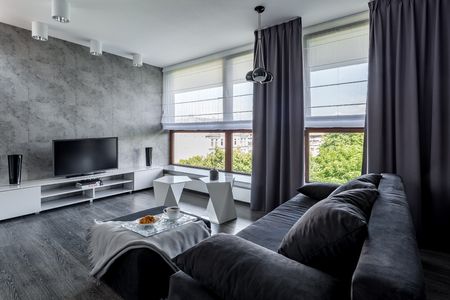 Photo pour Modern tv living room with couch, new design coffee table and big windows - image libre de droit