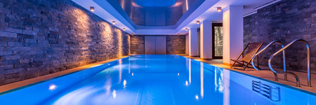 Photo for Luxurious villa swimming pool with brick walls, evening view, panorama - Royalty Free Image