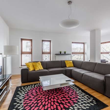 Modern living room with extra large sofa, coffee table and ...