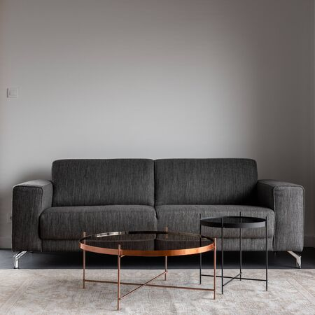 Photo pour Home interior with gray sofa and metal coffee table - image libre de droit