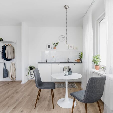 Photo pour Modern kitchen interior with round dining table and two chairs - image libre de droit