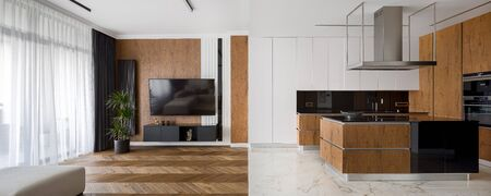 Photo pour Panorama of luxury designed kitchen and living room, with marble tiles and hardwood parquet floor - image libre de droit