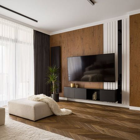 Photo pour Elegant designed living room with big television screen, wooden floor and wall - image libre de droit
