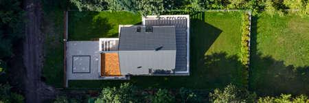 Photo pour Panorama of elegant house exterior with nice green lawn garden, drone view - image libre de droit