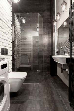 Photo for Elegant bathroom with shower behind glass wall, white brick and dark gray tiles - Royalty Free Image