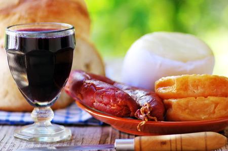 Portuguese bread, wine, cheese and chorizo