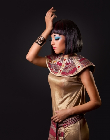 Low key. Looking down. Portrait of a beautiful Egyptian woman. Stage make up