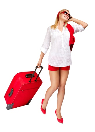 Photo pour Sexy woman  pulling vacation suitcase talking on phone. Isolated on white - image libre de droit
