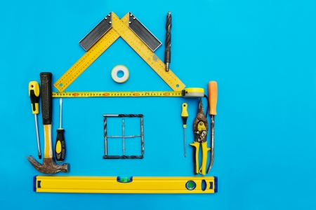 Photo pour Tools in the shape of house over blue background. Home improvement concept. - image libre de droit