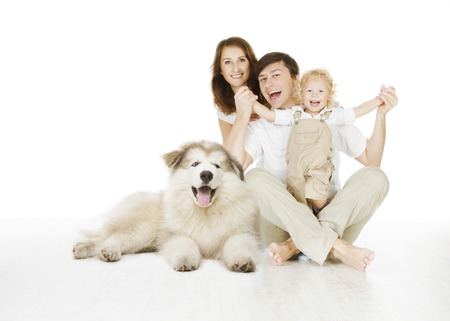Foto de family and dog, happy smiling father mother and laughing baby child isolated over white background - Imagen libre de derechos