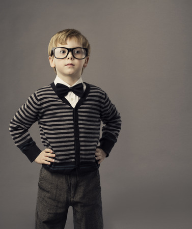boy in glasses, little child portrait, kid smart casual clothing, arms on hips