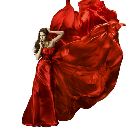 Photo pour Woman Beauty Fashion Dress, Girl In Red Elegant Silk Gown Waving Fabric, Model In Long Fluttering Cloth On Wind, Isolated Over White Background - image libre de droit