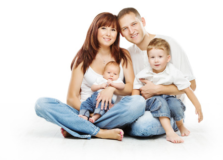 Foto de Young family four persons, smiling father mother and two children sons, over white background  - Imagen libre de derechos