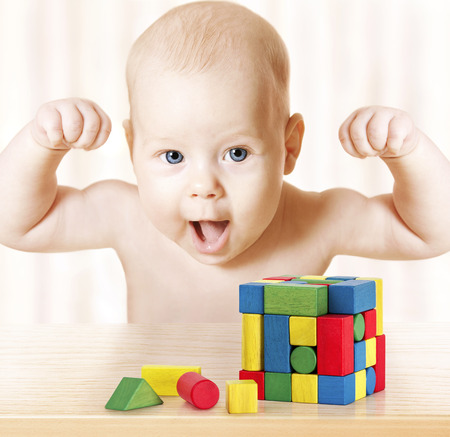Foto de Smart Baby Playing Toy Blocks, Strong Healthy Child Laughing, Hand Raise Up, Little Kids Success Early Development and Activity Concept, Jigsaw Puzzle Game - Imagen libre de derechos
