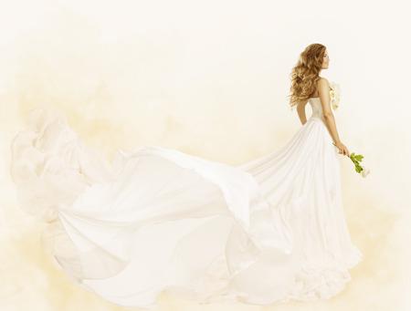 Foto de Long Dress, Woman Beauty Yellow Gown with Flower, Fashion Festive Clothes - Imagen libre de derechos