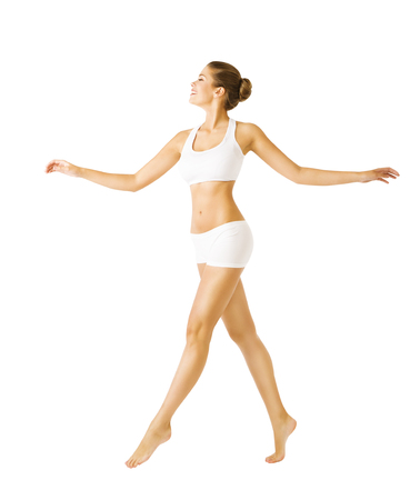 Foto de Woman Walking Side View, Sexy Girl in Cotton Underwear, People on White - Imagen libre de derechos