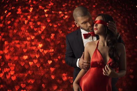 Sexy Couple Love, Man in Suit Undress Woman Blindfold, Red Heart Romanceの写真素材