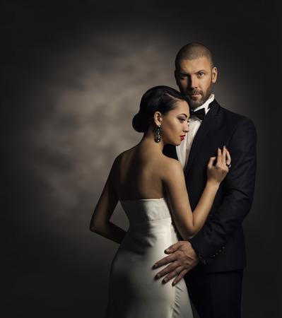 Foto de Couple in Black Suit and White Dress, Rich Man and Fashion Woman - Imagen libre de derechos