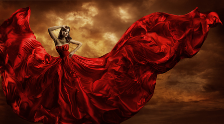 Photo pour Woman Red Dress Flying Silk Fabric, Fashion Model Dance in Storm Wind - image libre de droit