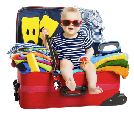 Foto de Baby Travel Vacation Suitcase. Kid in Packed Luggage, Family and Child Holiday - Imagen libre de derechos