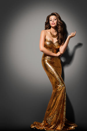 Fashion Model Girl Posing Glamour Gold Dress, Elegant Woman Golden Gown