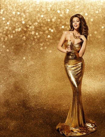 Photo pour Woman Gold Dress, Fashion Model with Champagne in Long Golden Gown, Vip Girl Celebrating Holiday over Sparkles background - image libre de droit