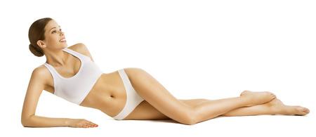 Photo pour Woman Slim Body Beauty, Beautiful Model in Underwear Lying over White Background - image libre de droit
