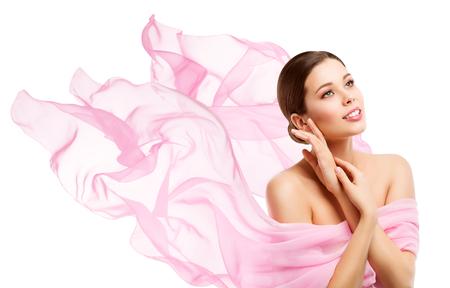 Foto de Woman Beauty, Happy Model Face Makeup, Girl looking side away in waving pink fabric, White Background - Imagen libre de derechos