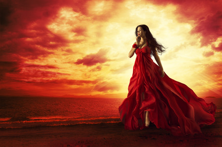 Photo pour Woman Flying Red Dress, Fashion Model in Evening Gown Levitating Outdoors, Sunset - image libre de droit