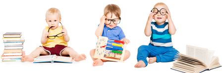 Foto de Baby Reading Book, Kids Early Education, Smart Children group in Glasses, white isolated - Imagen libre de derechos