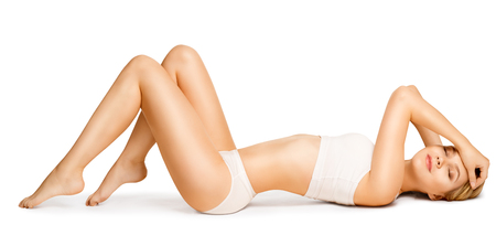 Foto de Body Beauty, Slim Woman in Cotton Underwear Lying Down on Back, Happy Dreaming Girl Isolated over White Background - Imagen libre de derechos