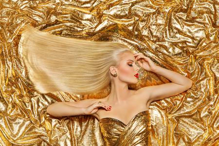 Foto de Gold Hair, Fashion Model Golden Straight Hairstyle, Blonde Girl on Shiny Sparkles Background - Imagen libre de derechos