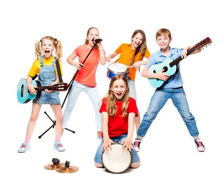 Photo pour Children Group Playing on Music Instruments, Kids Musical Band over White Background - image libre de droit