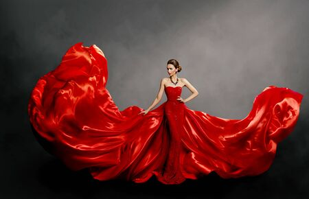 Photo pour Woman Red Dress, Fashion Model in Long Silk Gown Waving Cloth on Wind, Flying Fluttering Fabric - image libre de droit