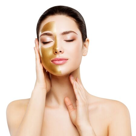 Photo for Woman Beauty Gold Mask , Beautiful Girl applying Golden Skin Cosmetic to Face - Royalty Free Image