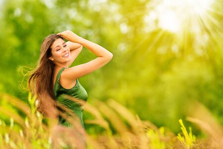 Photo for Outdoor Portrait of Happy Young Woman in Nature. Attractive Girl in Sunny Summer Green Park - Royalty Free Image
