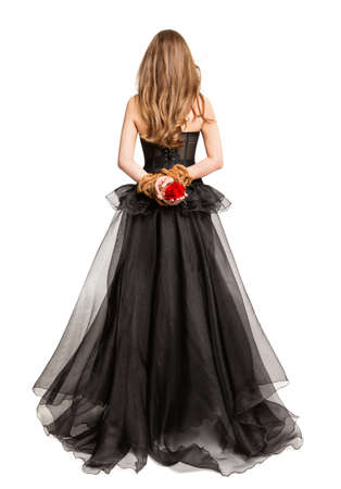Photo pour Gothic Woman in Black Dress Back Rear View, Flower Rose in Hands Tied By Rope, Cut out White Studio Background - image libre de droit