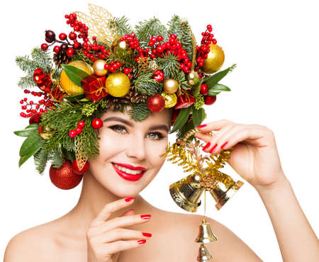 Photo for Christmas Woman Gift Bells. Beautiful Girl Fashion Make up and Xmas Party Wreath Hairstyle. Isolated White - Royalty Free Image