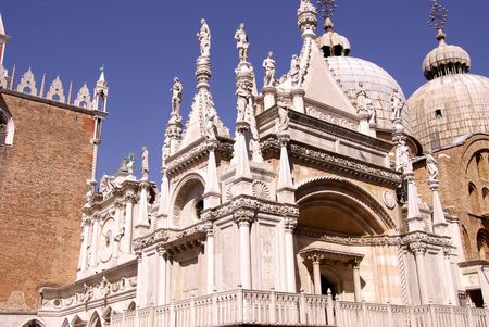 Carved marble facade in the courtyard of the Doge palace in Venice, Italy