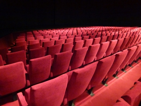 Rows with red chairs in a theatre