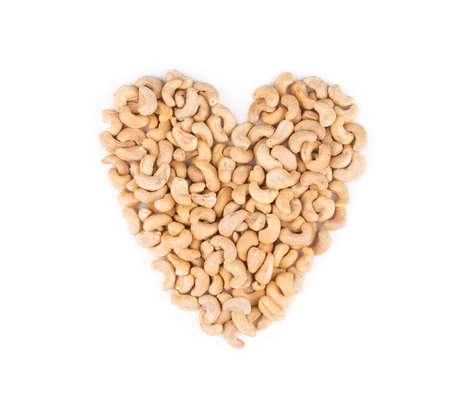 Heart shape from cashew. Isolated on a white background.