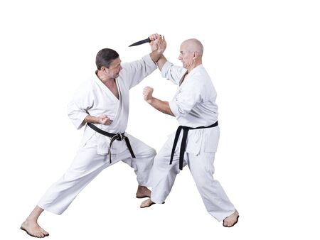 Photo for Adult athlete performs formal goju-ryu exercises isolated in a white - Royalty Free Image