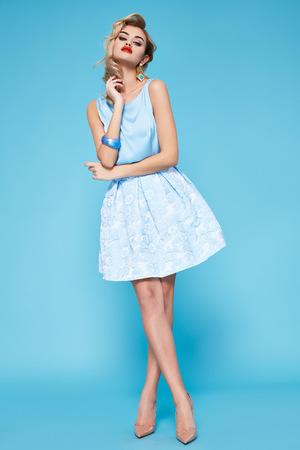 Foto de Beautiful sexy young business woman blond hair with evening make-up wearing a dress  - Imagen libre de derechos