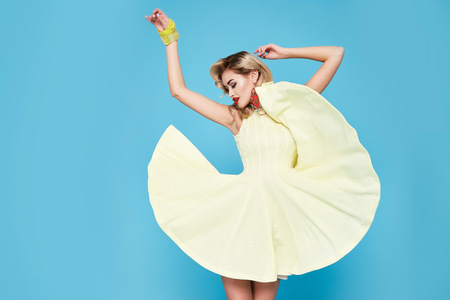 Photo pour Beautiful sexy young business woman blond hair with evening make-up wearing a dress  - image libre de droit
