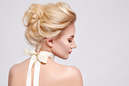 Photo pour Tender fashion portrait of beautiful gentle young blond woman with silk bow on the neck cosmetics for body face hair pure natural beauty, organic and diet harmony, makeup - image libre de droit