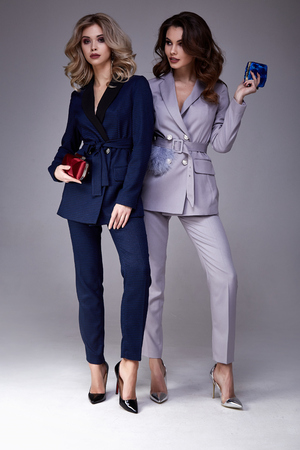 Photo for Two beautiful glamour sexy woman friend colleague wear formal dress coat suit jacket pants fashion shoes accessory bag natural beauty perfect body shape clothes meeting walk party date casual office. - Royalty Free Image