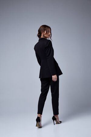Photo for Sexy beautiful woman fashion glamour model brunette hair makeup wear black suit trousers jacket clothes office dress code casual party style accessory date walk girl skinny body shape studio. - Royalty Free Image