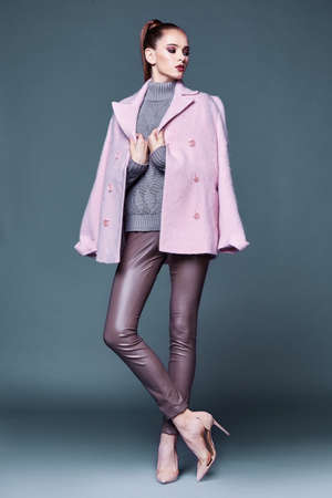 Photo pour Woman wear business style clothing for office casual meeting outwear cashmere coat pink wool knitted sweater lather skinny pants fall collection casual formal for office beautiful face model glamor. - image libre de droit