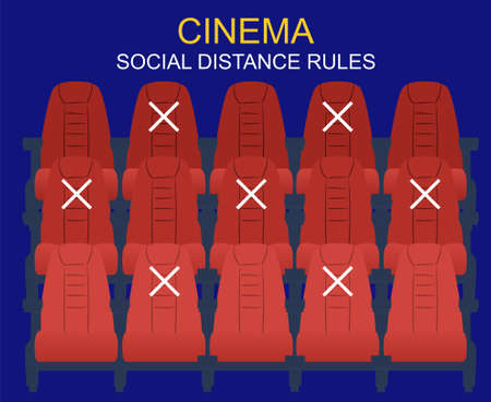 Social distance in the cinema. People keep their distance, sit through one chair, safe. There are few people in the Cinema Hall, virus protection.